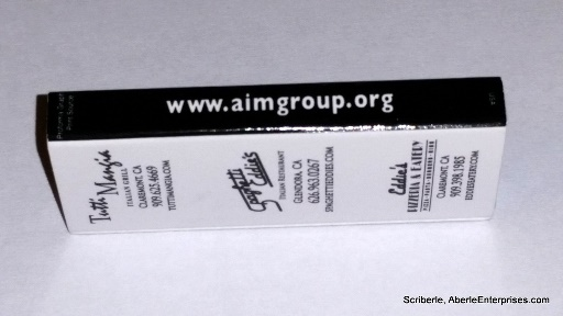 Picture of Aim Restaurant Group's different restaurants shown on back with URL of the group on the side of the box of toothpicks
