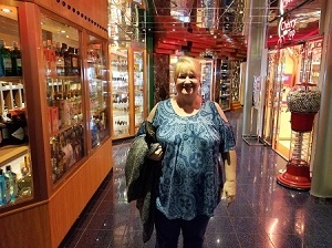 Picture of Dorothy Aberle at the entrance to the Shopping Mall of the Carnival Miracle Cruise