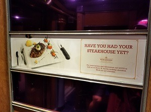 Picture of an ad banner for Nick & Nora's Steakhouse on Carnival Miracle